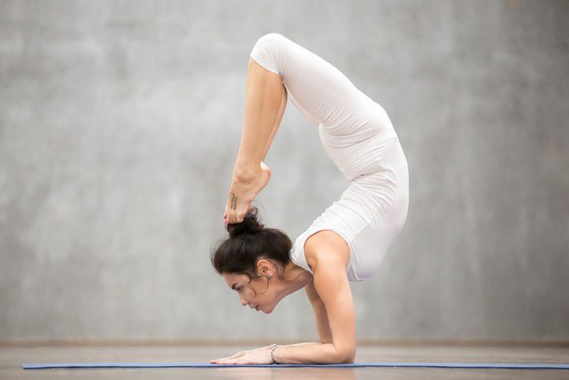 Handstand Scorpion Pose (Vrschikasana)