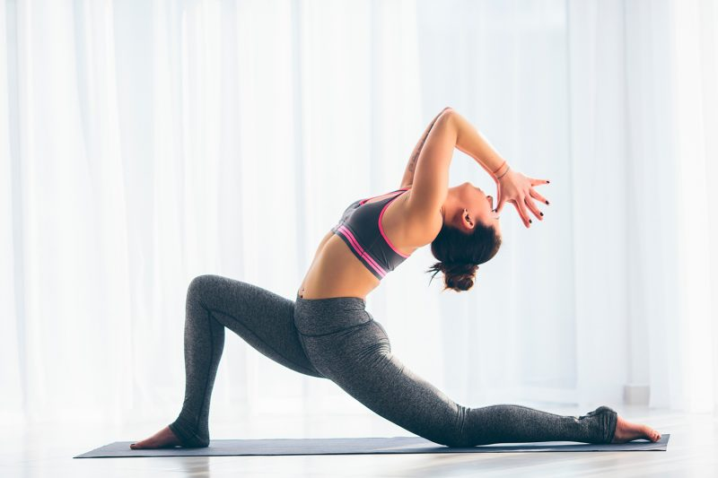 These Yoga & Pilates Moves Will Relieve Back Tension After a Stressful Day