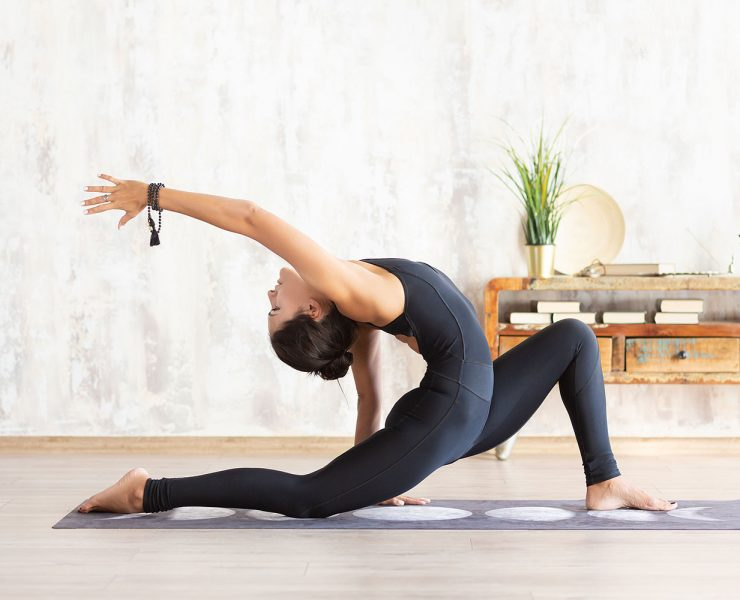 14 Yoga Poses to Speed Up Your Workout Recovery