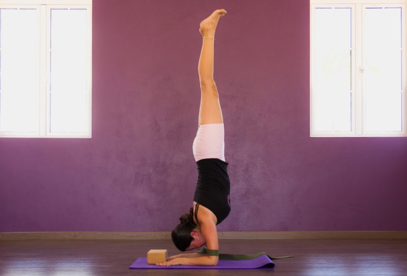 Pincha Mayurasana — Forearm Stand (by wall, using block and strap around arms)