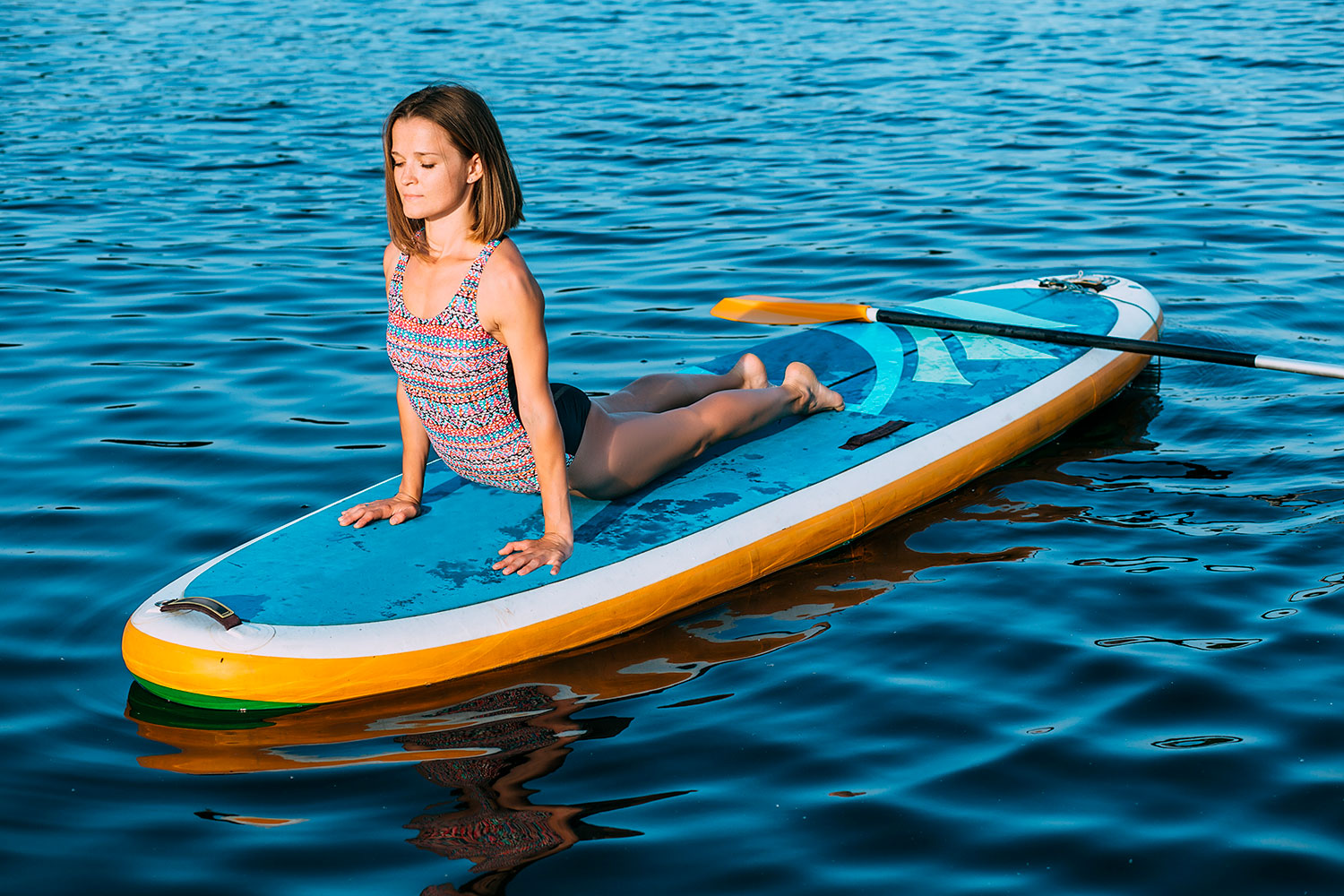 15 Beautiful and Relaxing Paddleboard Yoga