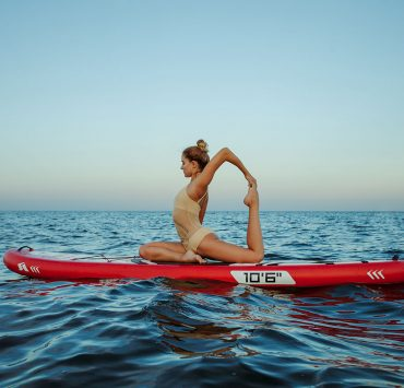Here's How You Get Fit on the Water With Paddleboard Yoga