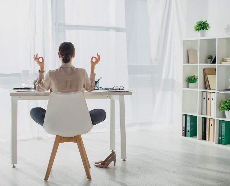 12 Yoga Poses You Can Do at Your Work Desk to Relieve Stress