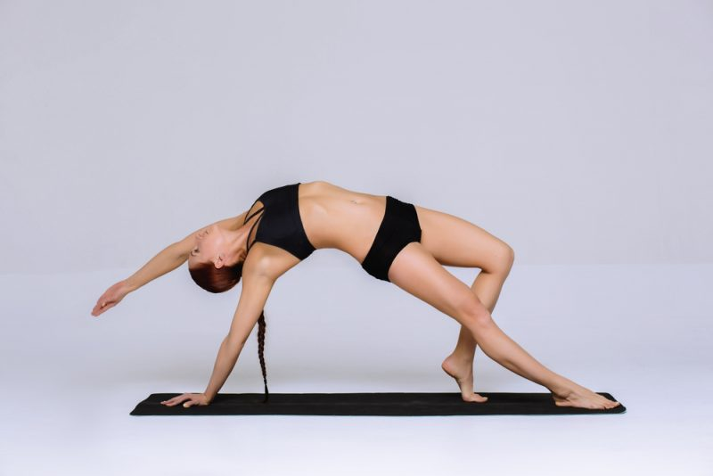 Camatkarasana — Wild Thing Pose
