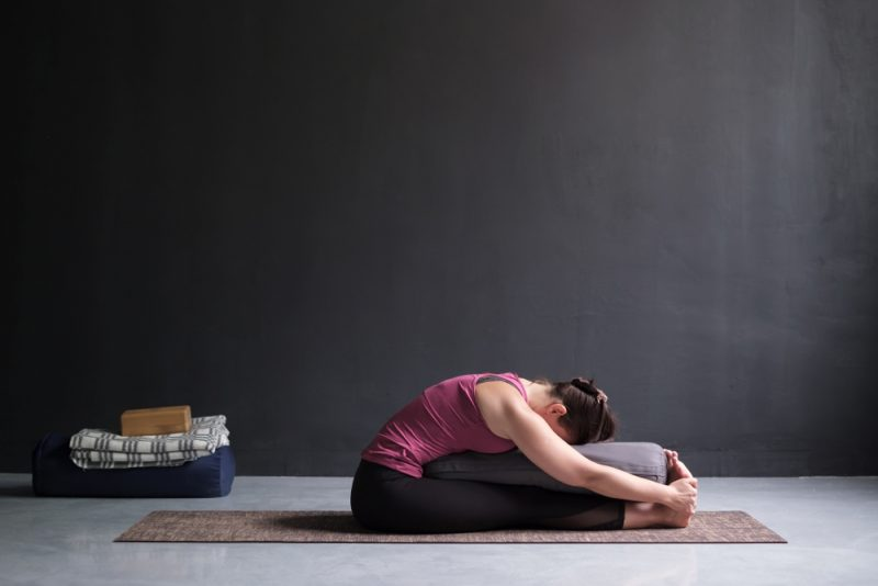 Paschimottanasana — Seated Forward Fold Pose with Bolster