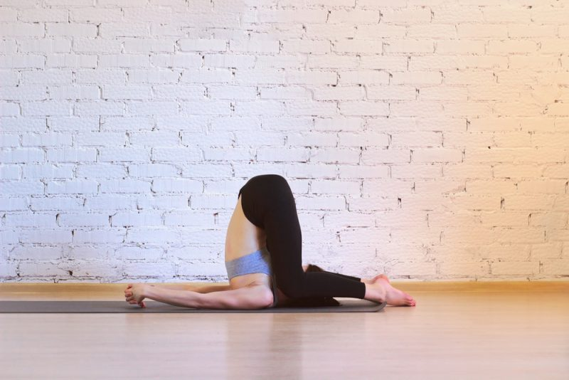 Karnapidasana — Knee to Ear Pose