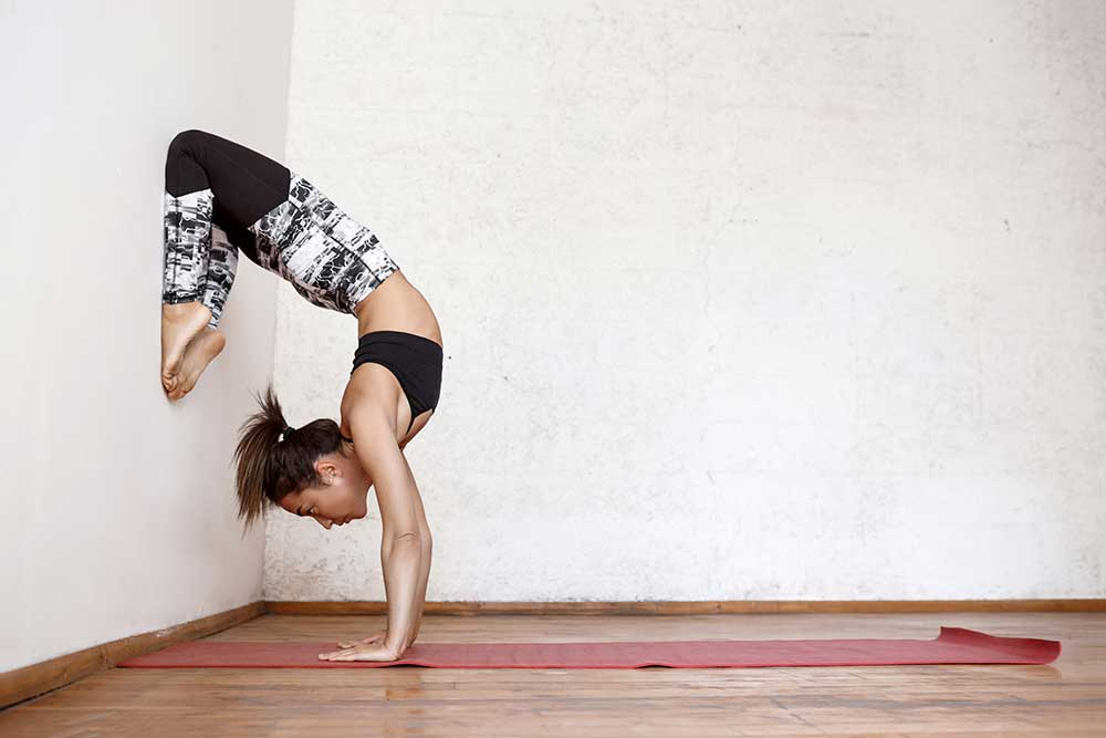 Taraksvasana — Handstand Scorpion Pose