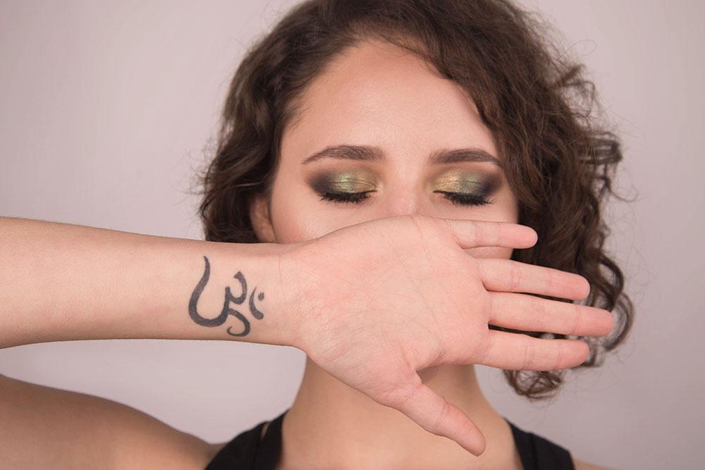 The 'OM' Symbol Tattoo