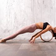 12 Poses To Try With A Yoga Wheel