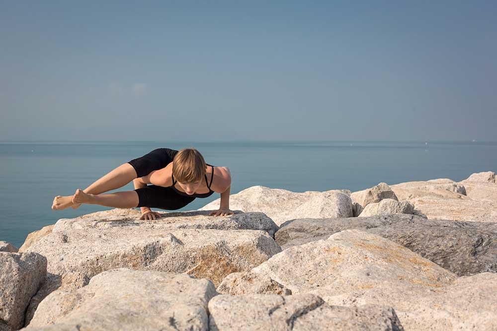 Astavakrasana — Eight Angle Pose