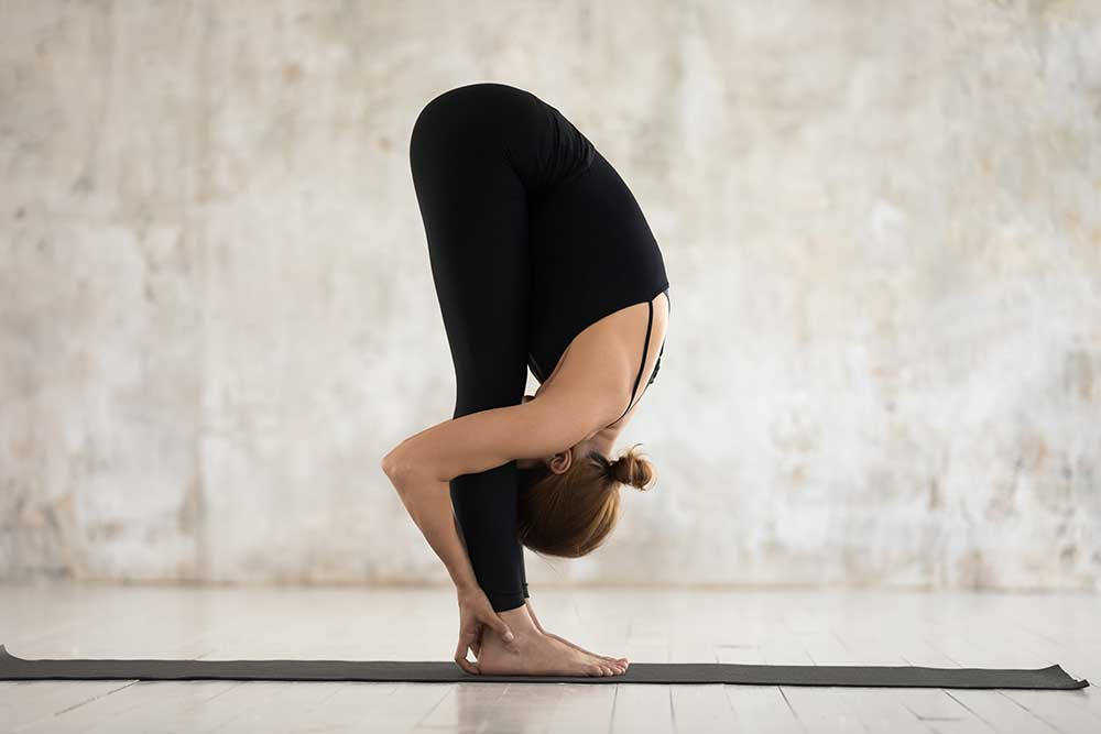 Exhale Uttanasana — Forward Fold Pose