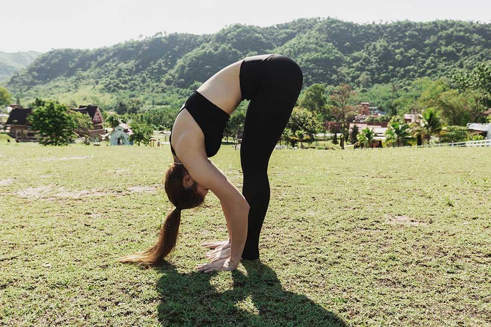 Exhale Uttanasana — Standing Forward Fold Pose