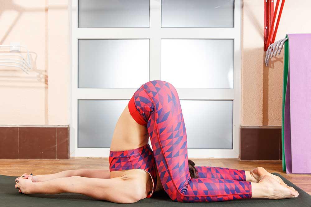 Karnapidasana — Ear to Knee Pose