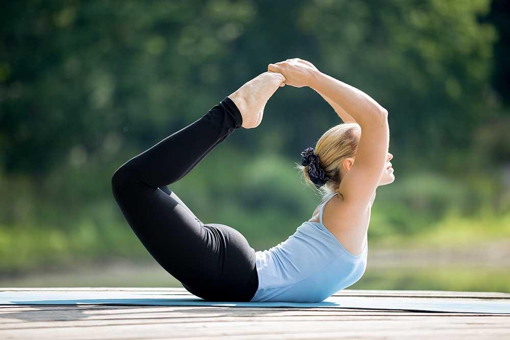 Padangustha Dhanurasana — Big Toe Bow Pose