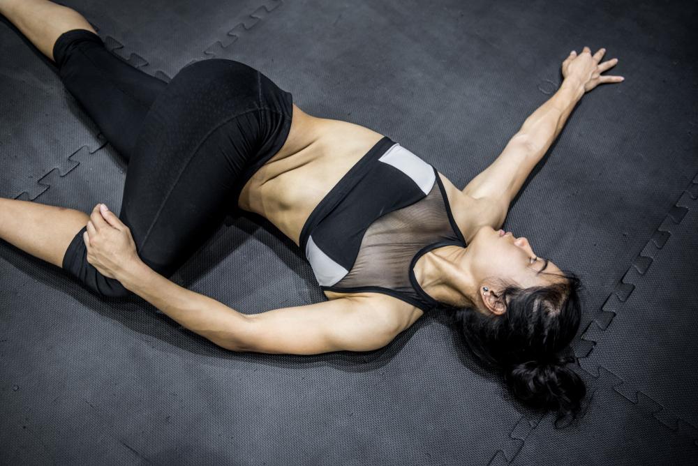 Supta Matsyendrasana — Supine Spinal Twist Pose