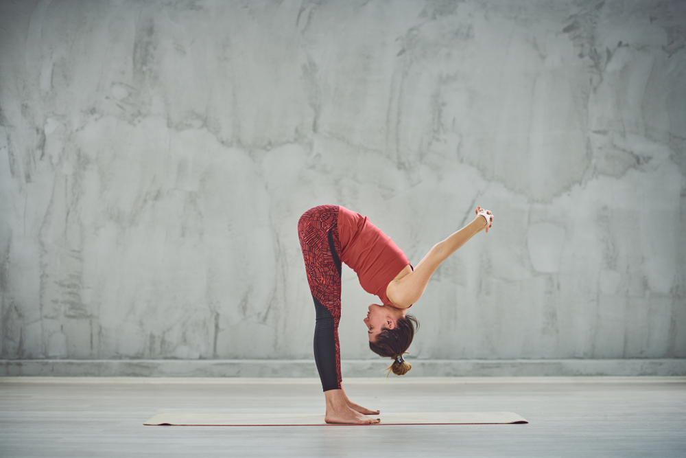 Uttanasana — Standing Forward Fold With Arm Bind Pose
