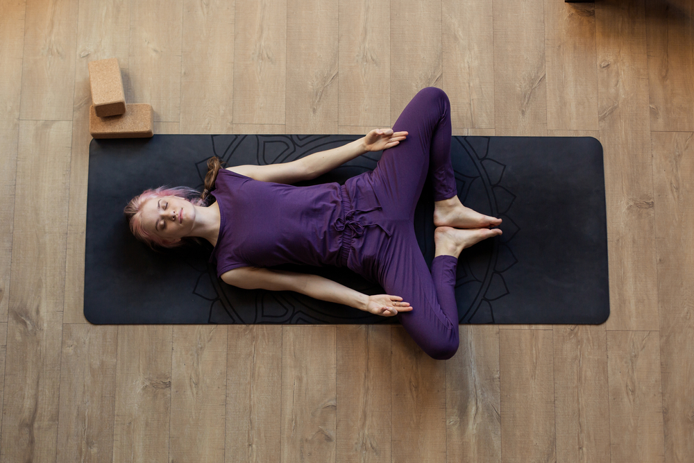 Supta Baddha Konasana — Reclined Butterly Pose